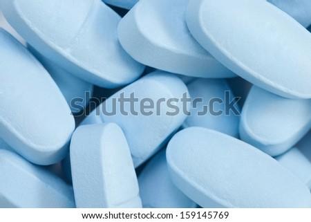 Bunch of blue pills - stock photo