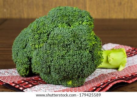 Bunch of broccoli on table - stock photo