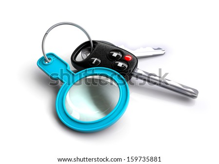 bunch of car keys with magnifying glass keyring. Concept for vehicle / car inspection and maintenance. - stock photo