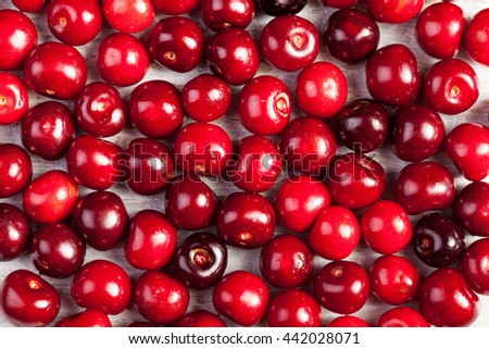Bunch of cherries on wooden table in close up photo. Summer freshness - stock photo