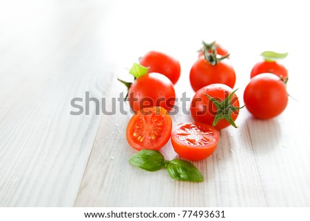 Bunch of cherry tomato and basil, traditional Italian.