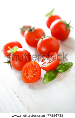 Bunch of cherry tomato and basil, traditional Italian. - stock photo