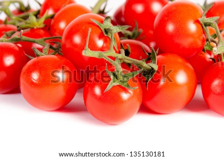 bunch of cherry tomatoes isolated on white background - stock photo
