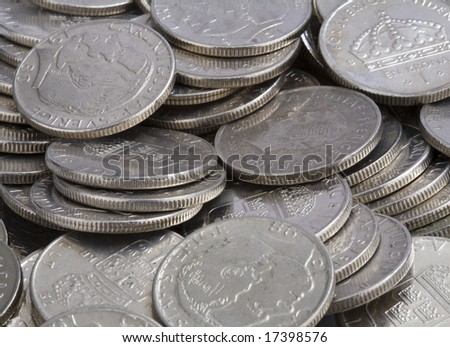 Bunch of coins that symbolize earnings after savings - stock photo