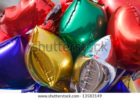 bunch of colored balloons with city mirror