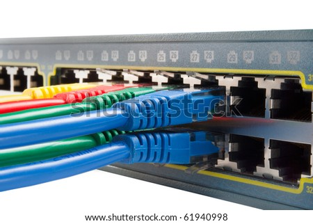 Bunch of Colored ethernet network cables connected to a switch isolated on white background. Top view