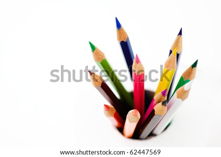 Bunch of colored pencils isolated on white background. Macro with extremely shallow depth of field - stock photo