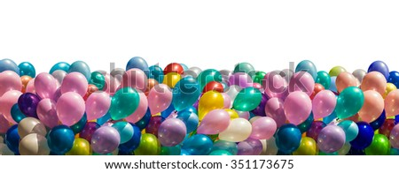 Bunch of colorful balloons border isolated on white - stock photo