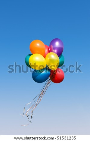 Bunch of colorful balloons in the blue sky - stock photo