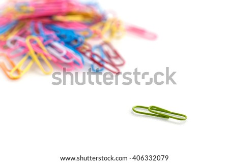 Bunch of colorful paper clips on white background - stock photo