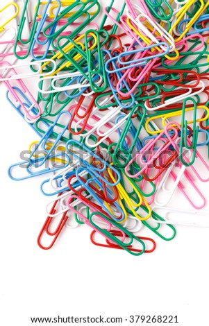 Bunch of colorful paper clips on white backgrpund photo