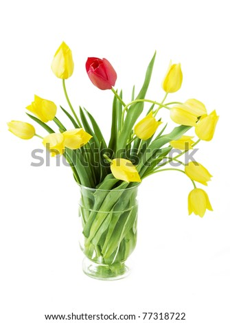 Bunch of decorative tulips in vase isolated on white