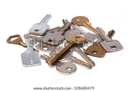 Bunch of different keys on white background - stock photo