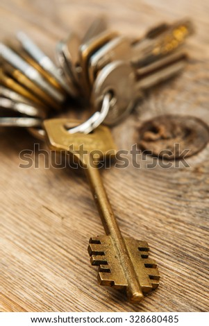 Bunch of different keys on wooden surface