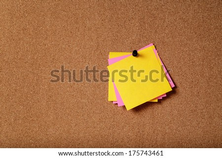 bunch of empty sticky notes on cork board - stock photo
