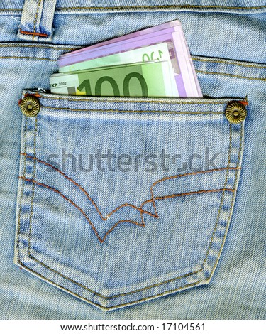 Bunch of Euro banknotes in the back pocket of a blue jeans. - stock photo