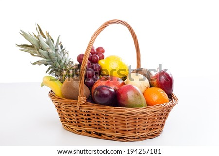 Bunch of exotic fruits in a big basket