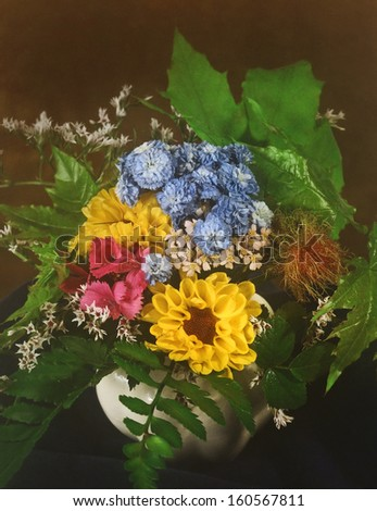 bunch of field flowers in a vase - stock photo