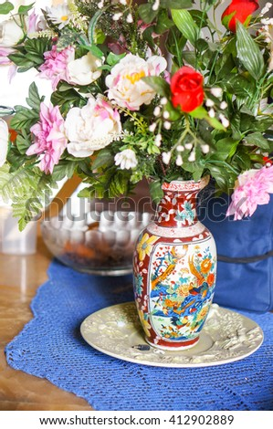 Bunch of flowers in a vase on table - stock photo