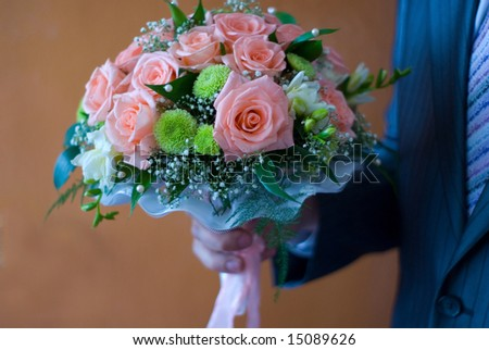 bunch of flowers in hand - stock photo