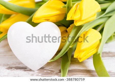 bunch of flowers with heart as symbol for love - stock photo