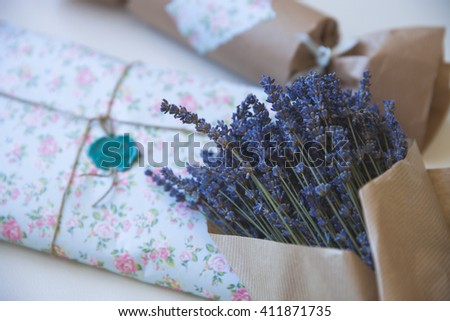 Bunch of French lavender in craft paper and nice gift package. Present and flowers. - stock photo