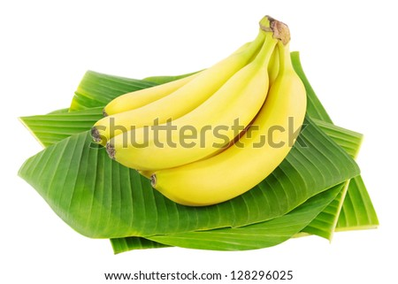 Bunch of fresh bananas on banana leaves - stock photo