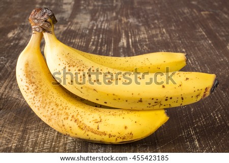 Bunch of fresh bananas on  wooden tabl - stock photo