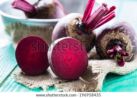 Bunch of fresh beetroot on wooden table - stock photo
