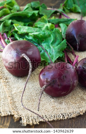Bunch of fresh beetroots on wooden background - stock photo