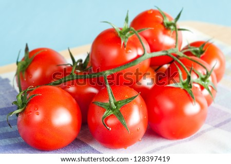 Bunch of fresh cherry tomatoes on a kitchen cloth