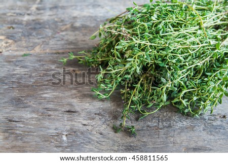 bunch of fresh estragon on a wooden table background.