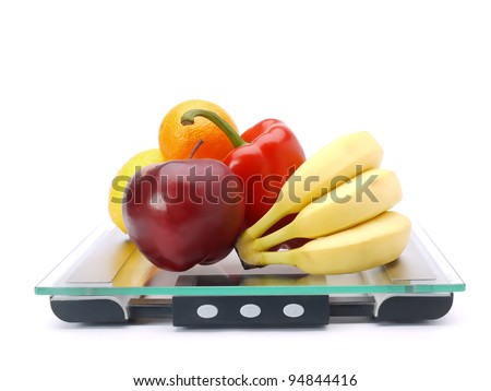 Bunch of fresh fruits and vegetables on glass bathroom scales shot on white - stock photo