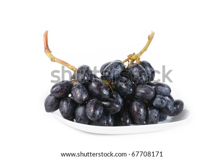bunch of fresh grapes in plate isolate on white