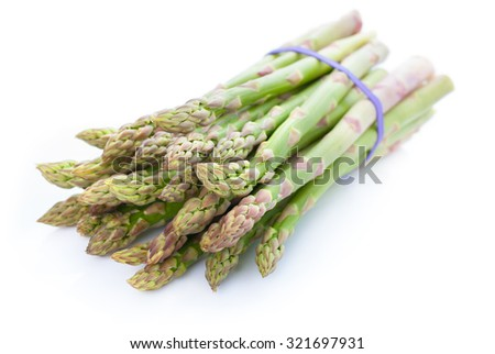 Bunch of fresh green asparagus isolated on white background - stock photo