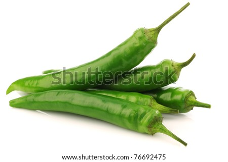bunch of fresh  green chili peppers on a white background - stock photo