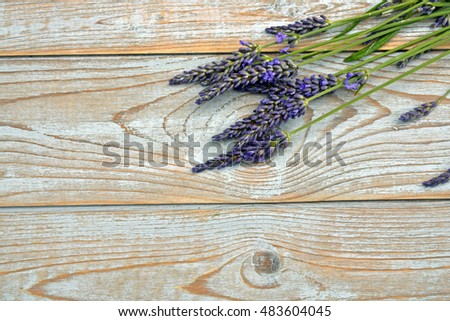 Bunch of fresh lavender on a grey wooden planks table in vintage style with empty copy space