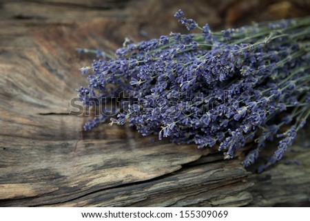 Bunch of fresh lavender on a old wooden rustic background - stock photo