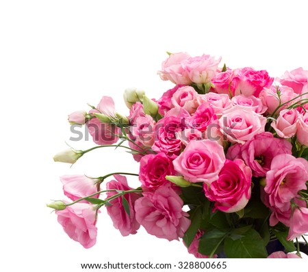 bunch of fresh pink  roses and eustoma flowers close up isolated on white background
