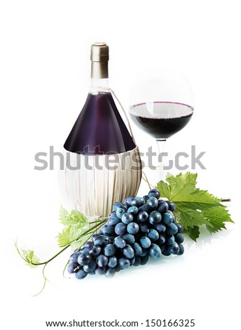 Bunch of fresh purple grapes with trailing vine leaves on a white background with a bulbous bottle and glass of red wine - stock photo