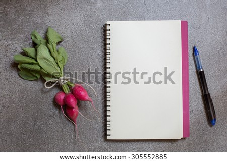 bunch of fresh radish with a copy-book