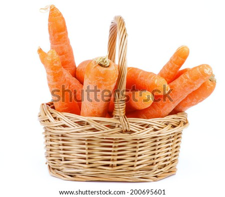 Bunch of Fresh Raw Carrot in Wicker Basket isolated on white background - stock photo