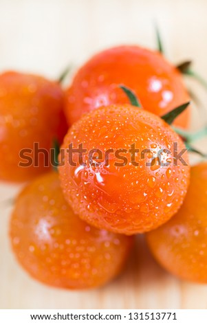 Bunch of fresh red cherry tomatoes, closeup, selective focus