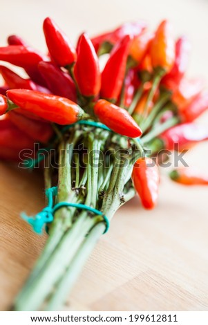 Bunch of fresh red chili peppers - stock photo