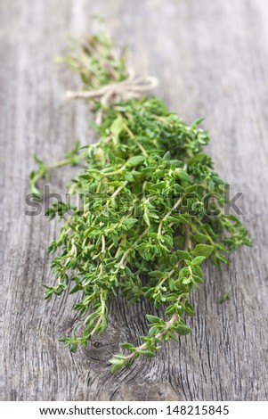Bunch of fresh thyme on wooden table