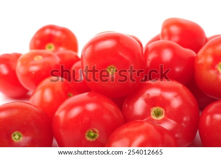 Bunch of fresh tomatoes with water drops. Isolated on white  - stock photo