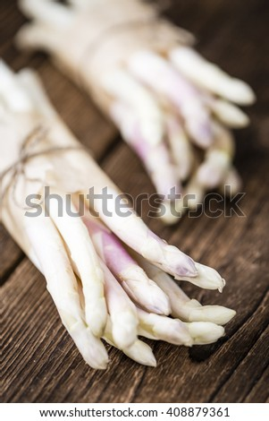 Bunch of fresh white Asparagus (close-up shot; selective focus) on wooden background - stock photo