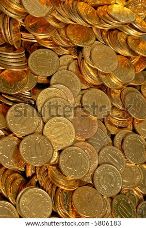 Bunch of golden coins ten close up - stock photo