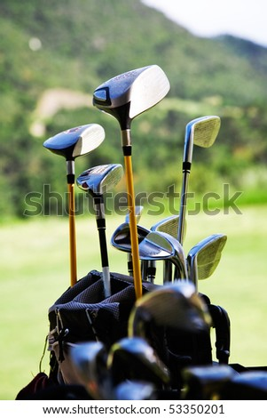 Bunch of golf clubs in the bag - stock photo