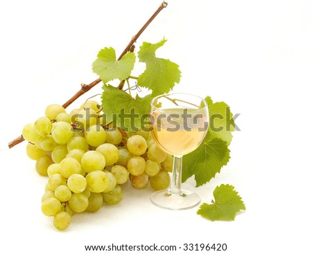 bunch of grapes and glass of white wine isolated on white background